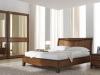 camera-cristina-in-noce-letto-con-testiera-in-legno-e-armadio-con-specchi